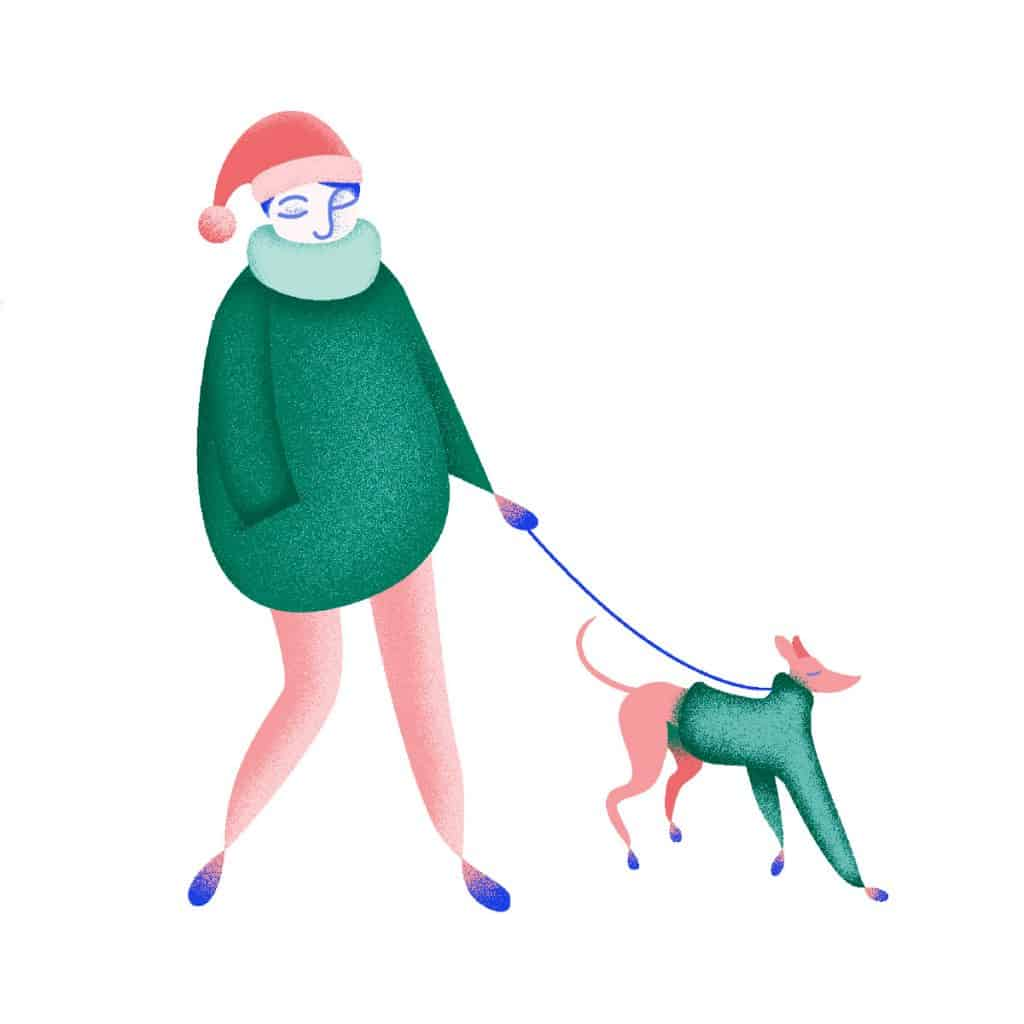 Image d'une jeune femme promenant son chien.